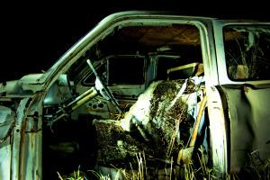 Decaying interior of 1950's era sedan captured via light painting