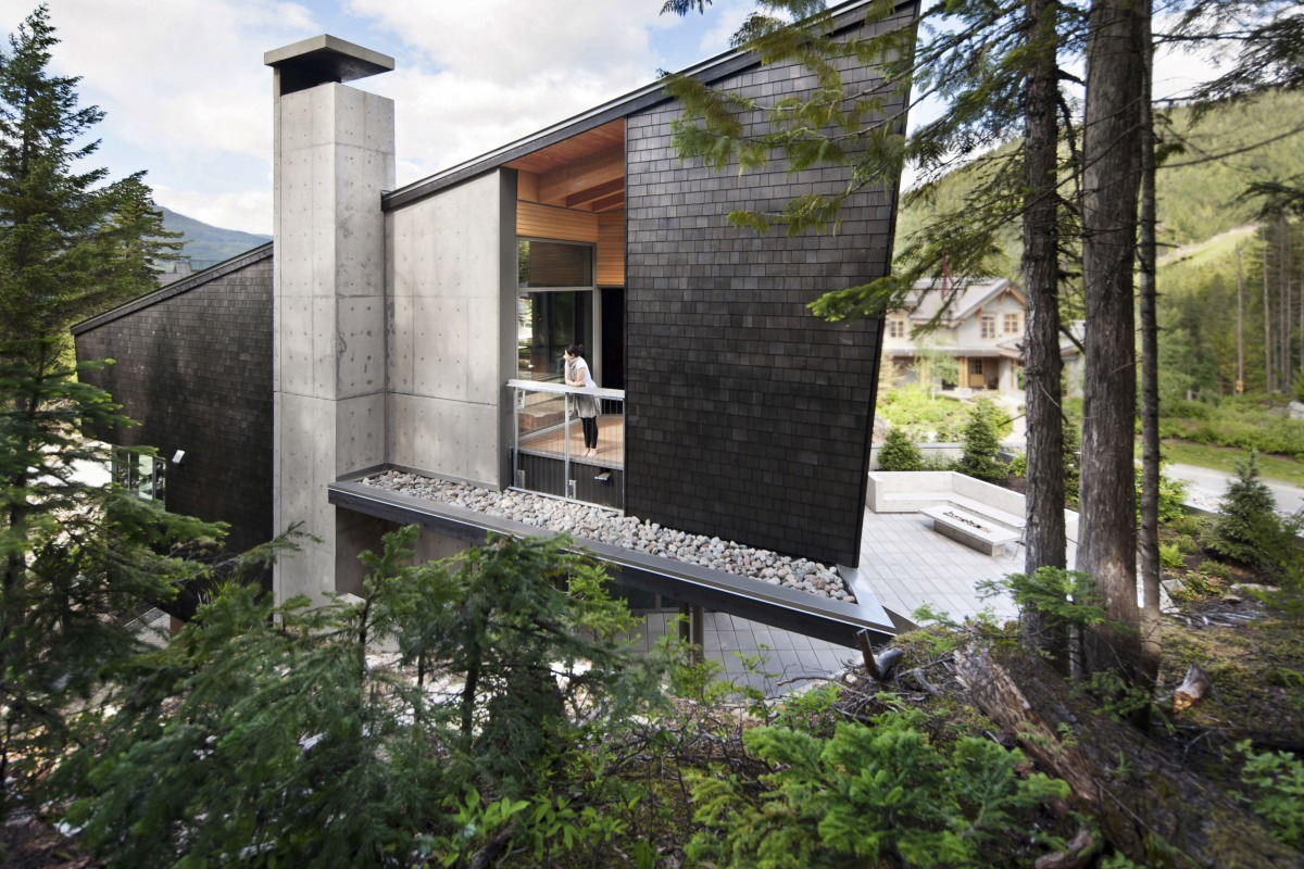 BattersbyHowat Architects' concrete & wood triangular residence hides its massive footprint in plain sight - slide 1