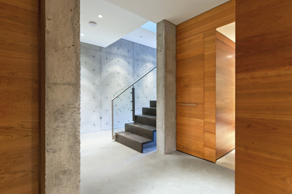 BattersbyHowat Architects' concrete & wood triangular residence hides its massive footprint in plain sight - slide 3