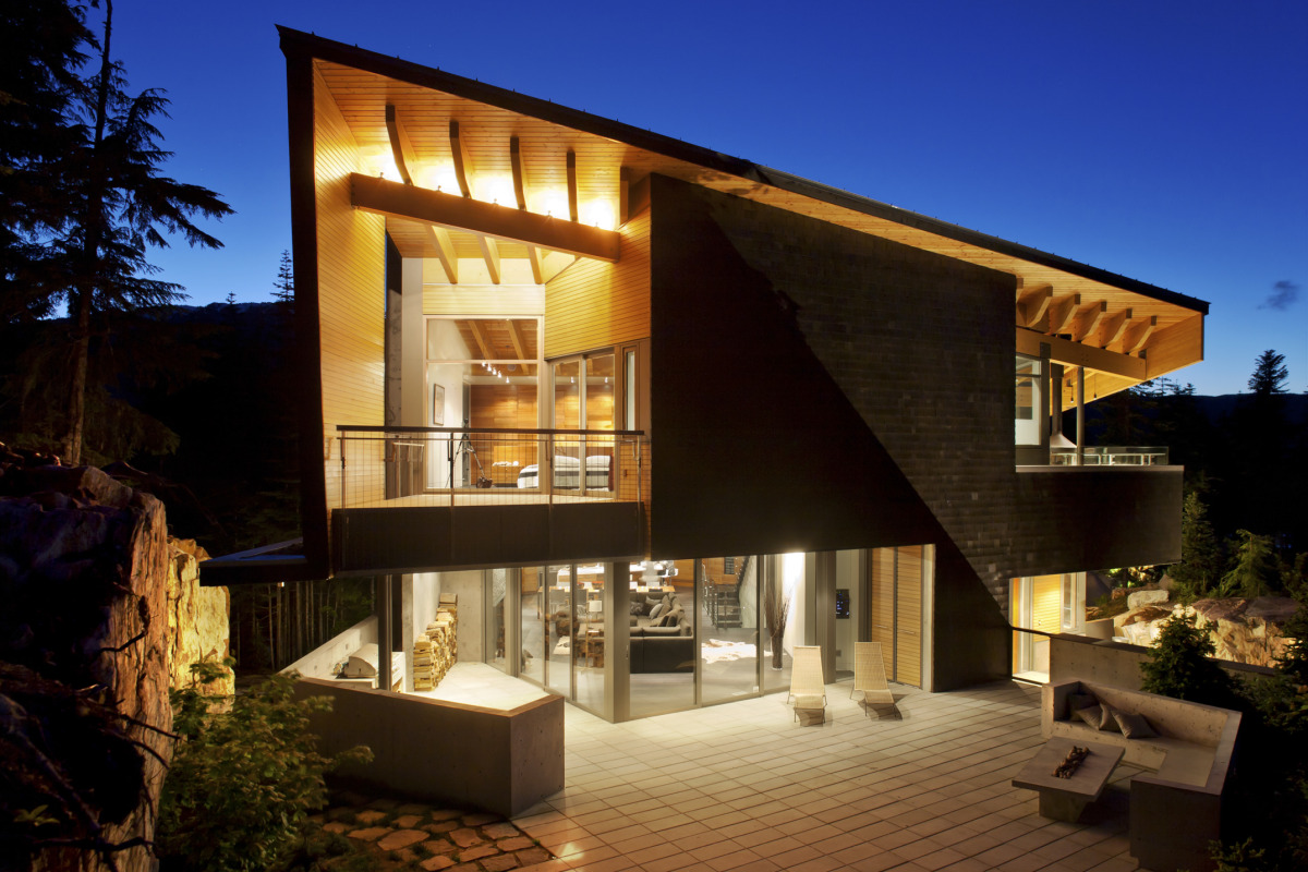 BattersbyHowat Architects' concrete & wood triangular residence hides its massive footprint in plain sight - slide 8