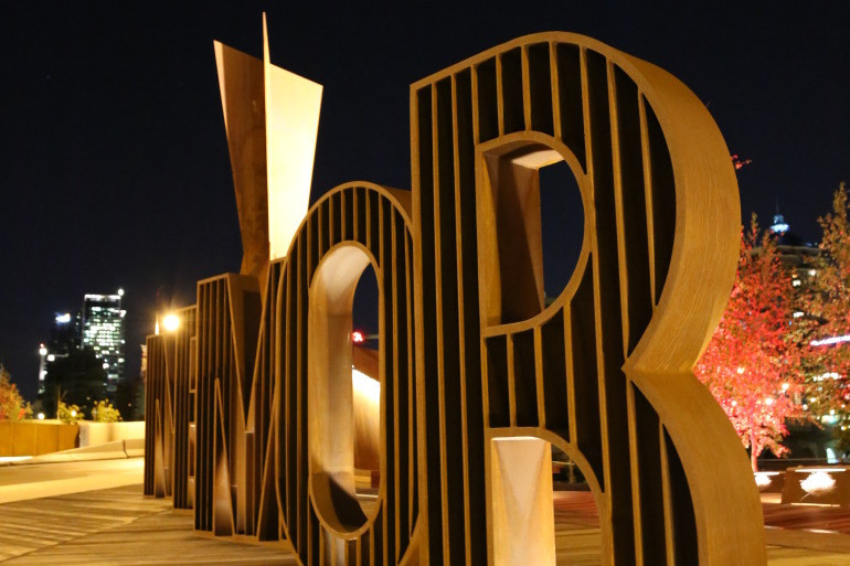 Water-cut typography on patina covered elements embody the narrative behind Calgary's Poppy Plaza - slide 10