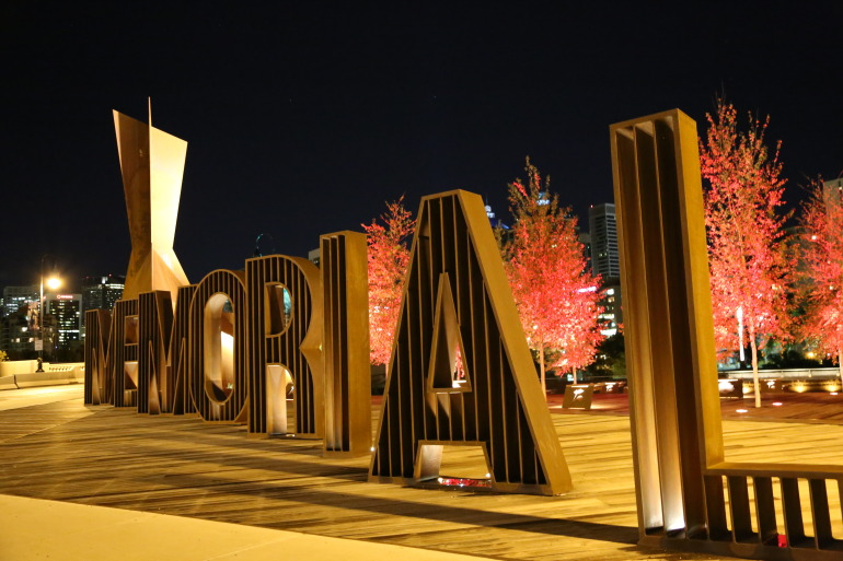 Water-cut typography on patina covered elements embody the narrative behind Calgary's Poppy Plaza - slide 17