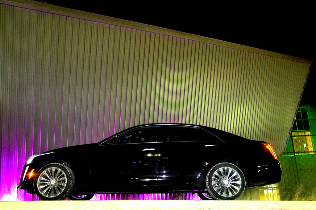 Cadillac's angular AWD luxury barge poised in front of the SPARK Science Ctr